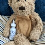 teddy bear holding childrens sleep aid