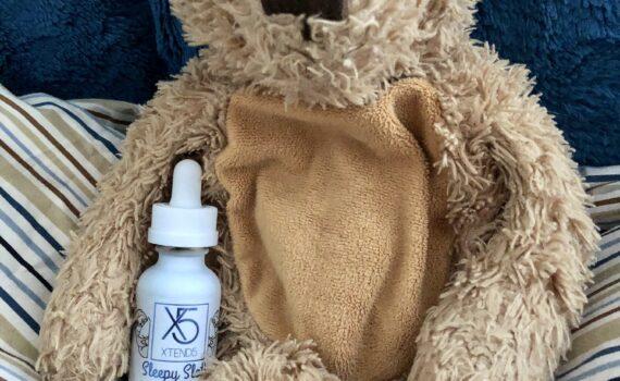 teddy bear holding childrens sleep aid