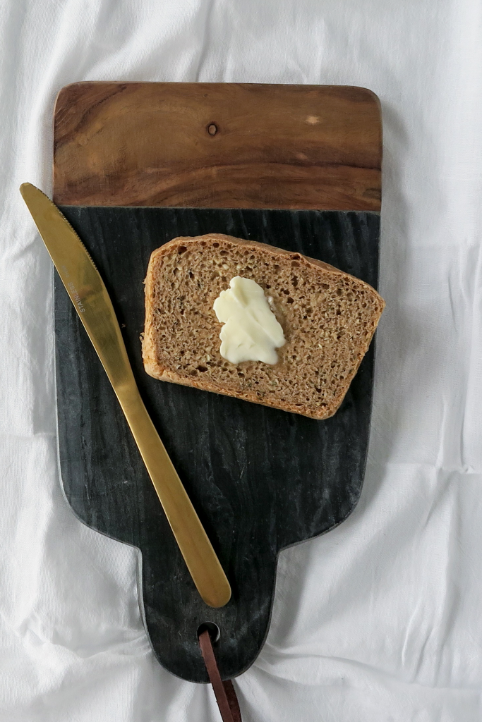slice of bread with butter and knife