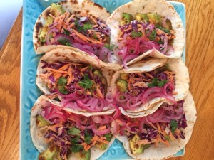 Avocado Tacos with quick pickled onions and goddess slaw