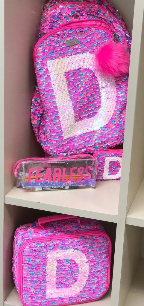Back to school gear from Justice, the backpack, pencil case, lunch box, and wristlet in flip sequins are so much fun.