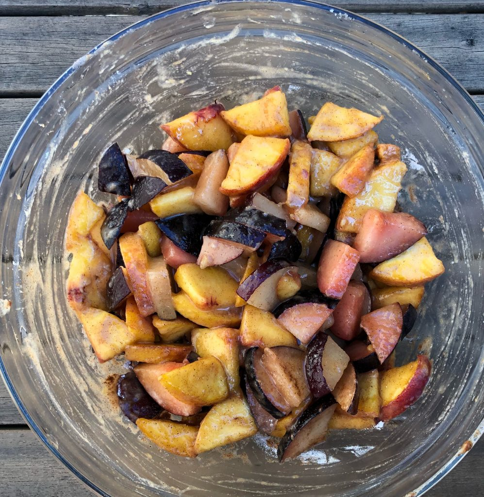 stone fruits cut up with a little allulose on them, ready to bake in a mini pie