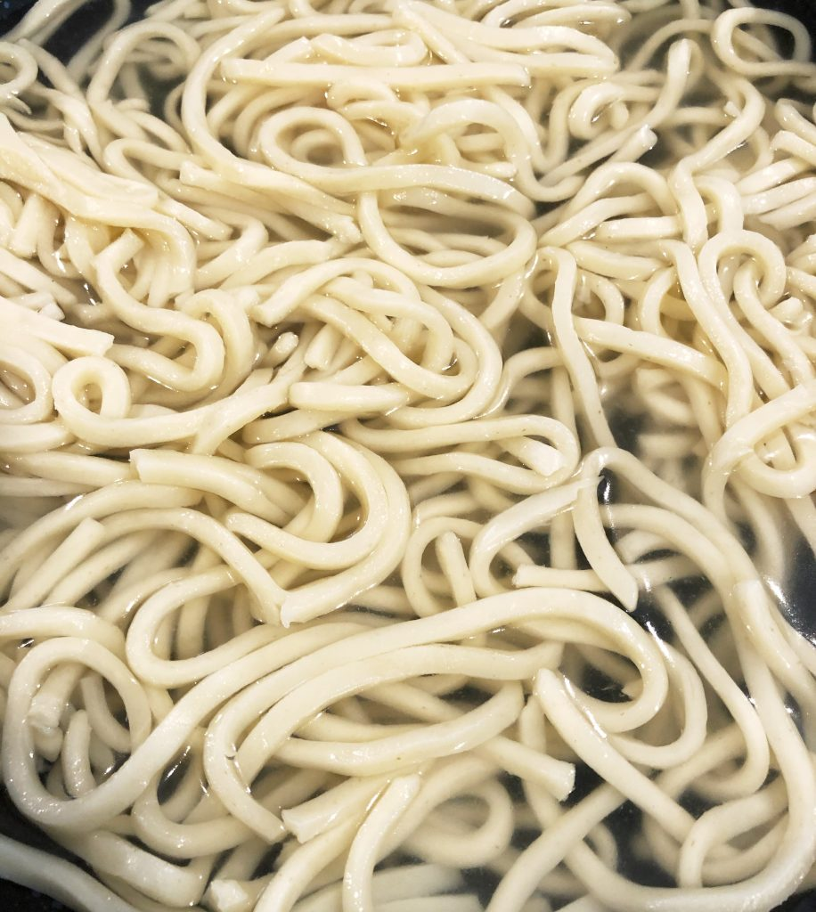 udon noodles in boiling water