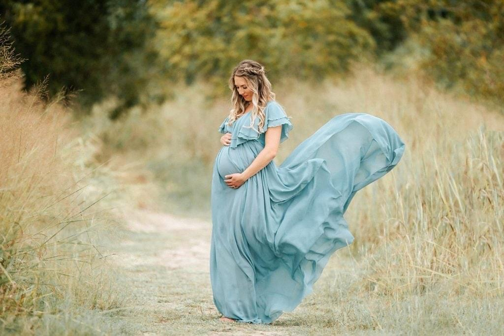 pregnant woman in flowing green dress