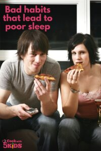 two people watching tv and eating pizza