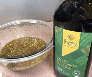 olive oil bottle next to vinaigrette