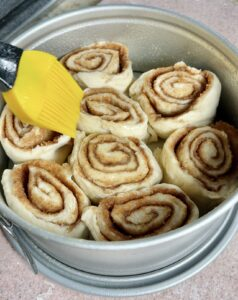 cinnamon rolls in the chefIQ with melted butter on top