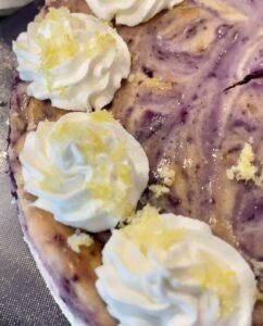 blueberry lemon cheesecake with homemade whipped cream and lemon sugar